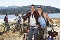 Couple Standing Together By Bicycle Royalty Free Stock Photo