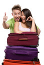 Couple stands near a pile of suitcases isolated on white concept romantic vacations and lovely honeymoon Stock Photography