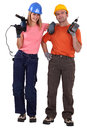 Couple stood with power drills Stock Photography