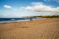 Couple strolling on Ballycastle Beach, Co. Antrim, Northern Ireland Royalty Free Stock Photo