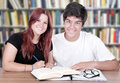 Couple of students in a library Stock Photo