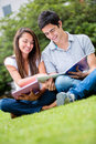 Couple of students outdoors Stock Photo