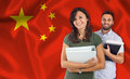 Couple of students over chinese flag Royalty Free Stock Photo