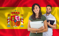 Couple of students over spanish flag Royalty Free Stock Photo