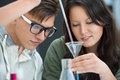 Couple of students working at chemistry classroom Royalty Free Stock Photo