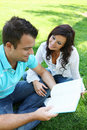 Couple Studying on Grass Royalty Free Stock Photo