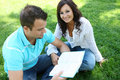 Couple Studying on Grass Royalty Free Stock Photos