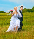 Couple summer outdoor wedding with flower running Royalty Free Stock Photos