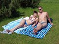 Couple sunbathing young men and women together on countryside Stock Photography