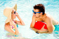 Couple with sunglasses in swimming pool. Summer, sun, water. Royalty Free Stock Photo