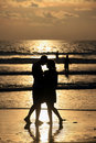 Couple on sunset. Royalty Free Stock Photo