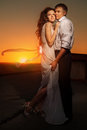 Couple in sunset Stock Photos