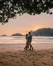 Couple during sunset on the beach Krabi Thailand, men and woman watching sunset at Ao Nam Mao beach Krabi Ao Nang area Royalty Free Stock Photo