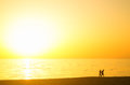Couple at sunset on the beach Royalty Free Stock Photo