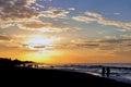 Couple on sunset beach walk Royalty Free Stock Photo