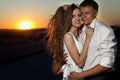 Couple in sunset embracing with amazing backdrop Stock Photography