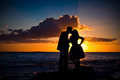 Couple at sunset kissing on the beach Royalty Free Stock Images