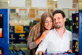 Couple in supermarket buying beverages Stock Photography