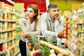Couple in supermarket image of young with cart Royalty Free Stock Photography