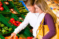 Couple in supermarket shopping groceries Stock Photos
