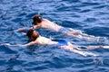 A couple swiming