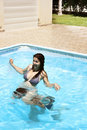 Couple in swimming pool Stock Photography