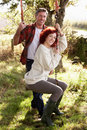 Couple on swing in the country Stock Photos