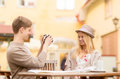 Couple taking photo picture in cafe summer holidays and dating concept at the city Royalty Free Stock Image
