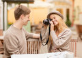 Couple taking photo picture in cafe summer holidays and dating concept at the city Stock Image