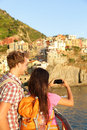 Couple taking photo on smartphone in cinque terre romantic using smart phone travel young men and women Stock Photography
