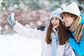 Couple taking picture of themselves having fun on winter day Royalty Free Stock Photos