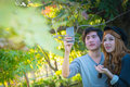 Couple taking pictures from mobile phones Royalty Free Stock Photo