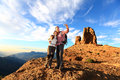 Couple taking selfie hiking in beautiful nature with smart phone happy walking enjoying view and pictures with Stock Image