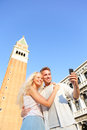Couple taking selfie picture on travel in venice love romantic piazza san marco young vacation holidays Stock Photos