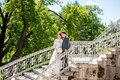 A couple taking wedding pictures in the Catherine Palace , a Rococo palace, the summer residence of the Russian tsars. St. Royalty Free Stock Photo