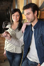 Couple tasting wine in cellar man and women Stock Images