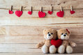 The couple teddy bear holding a heart shaped pillow valentine concept Stock Photos