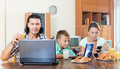Couple with teenager with device during breakfast happy a kid smart a in a house interior Royalty Free Stock Images