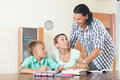 Couple with teenager schoolboy doing homework Royalty Free Stock Photo