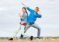 Couple of teenagers dancing outside summer holidays teenage and concept Royalty Free Stock Image