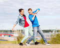 Couple of teenagers dancing outside summer holidays teenage and concept Royalty Free Stock Photos