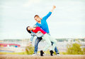 Couple of teenagers dancing outside summer holidays teenage and concept Royalty Free Stock Images