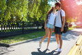 Couple teens in love walking in the park in summer day youth relationship concept Royalty Free Stock Images