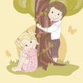 Couple  teens under tree . Royalty Free Stock Photography