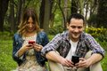 Couple texting messages sms while being together Stock Images