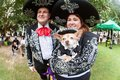 Couple And Their Chihuahua Wear Mariachi Costumes At Doggy Con