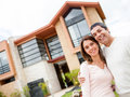 Couple with their house Stock Photos