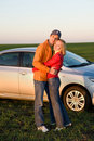 Couple with their new car Stock Photos