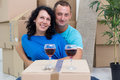 Couple in their new home with cardboard boxes happy Royalty Free Stock Image