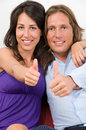Couple thumbs up sign Royalty Free Stock Photos